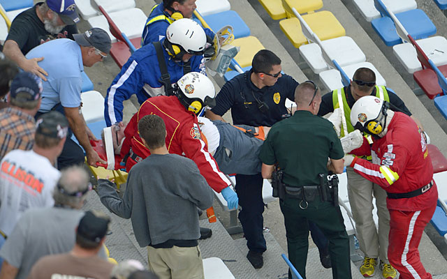 Emergency officials transport a spectator injured from a frightful last-lap accident. (AP)