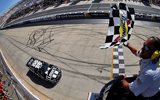 Jimmie Johnson takes the checkered flag at Dover to win back-to-back races for the 13th time. (Getty Images)