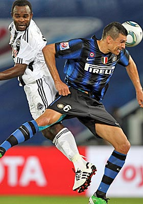 Inter Milan's Lucio heads the ball bast TP Mazembe's Dioko Kaluyituka during Saturday's final. (Getty Images)
