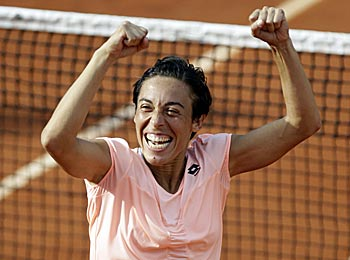 Francesca Schiavone takes another joyous step in defending her French Open title. (AP)