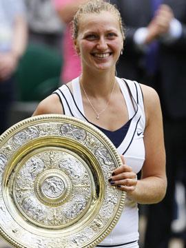 Petra Kvitova wins the Wimbledon title with countrywomen Martina Navratilova and Jana Novotna in the crowd. (AP)