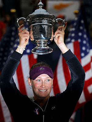With the American flag in the background on this special day in New York, Samantha Stosur enjoys her trophy. (Getty Images)