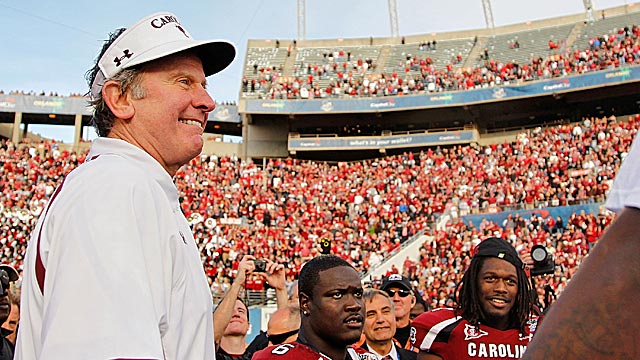Spurrier says his fellow SEC coaches support the idea of players receiving 'full-cost' scholarships. (Getty Images)