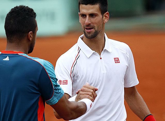 Djokovic survives through five sets against French favorite, fifth-seeded Tsonga. (Getty Images)