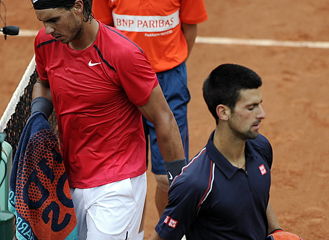 Nadal and Djokovic head for their respective chairs as a second rain delay is called Sunday. (Getty Images)