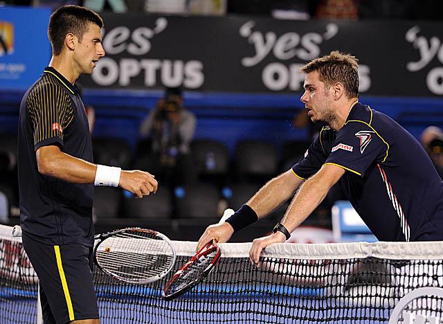 A worn-out Stanislas Wawrinka congratulates Djokovic on winning their epic five-setter. (AP)