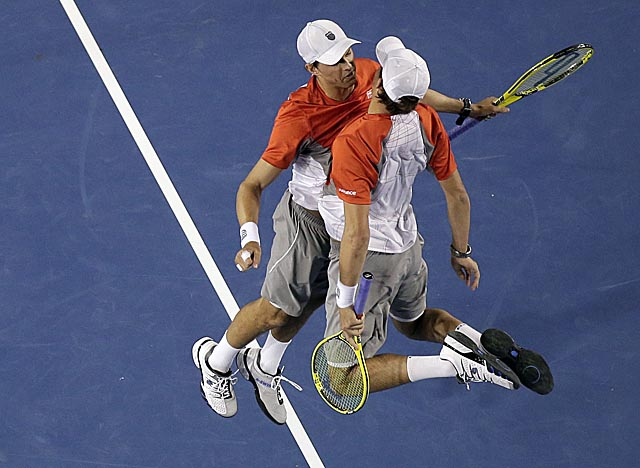 The Bryan twins celebrate their doubles win over Robin Haase and Igor Sijsling in Melbourne. (AP)