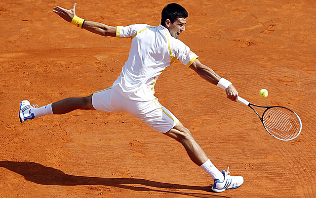 Djokovic guts out a two-game deficit in the second set to topple Rafa Nadal in Monaco. (Getty Images)