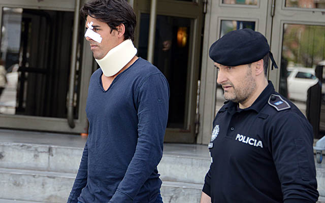 Thomas Drouet, Tomic's training partner, leaves a courthouse in Madrid on Monday. (Getty Images)