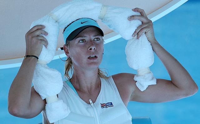 Maria Sharapova wraps herself in ice during a break in her second-round victory. (Getty Images)