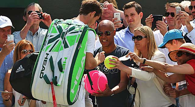 Andy Murray signs autographs after dispatching Blaz Rola. (Getty Images)