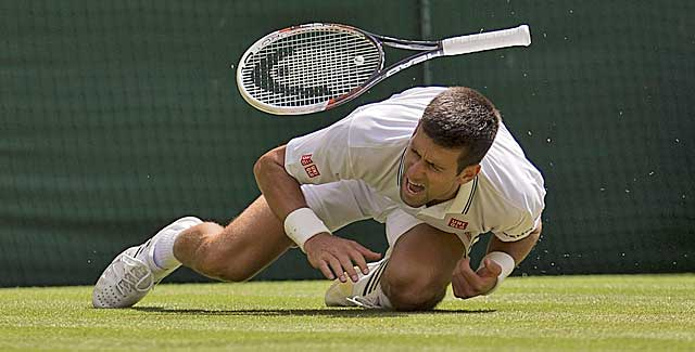 Top-seeded Novak Djokovic recovers from this tumble to advance at Wimbledon. (USATSI)