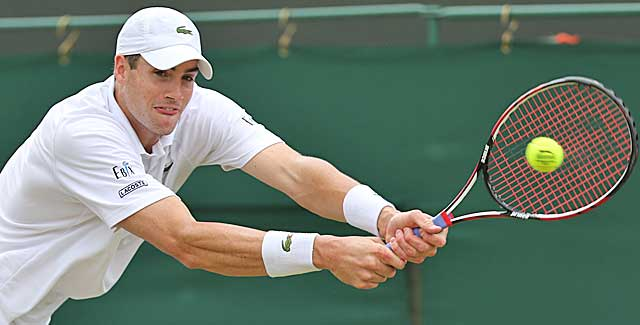 John Isner rips 52 aces, but is eliminated by Feliciano Lopez at Wimbledon. (Getty Images)
