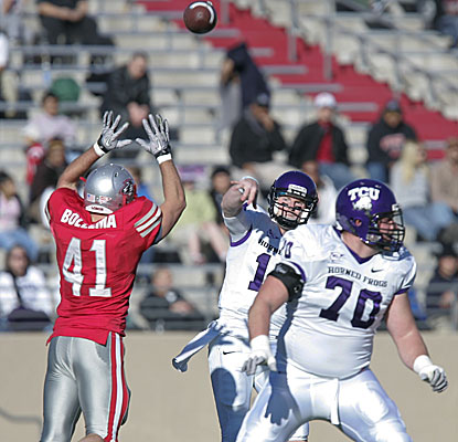 TCU quarterback Andy Dalton passes over New Mexico linebacker Dallas Bollema as Zack Roth (70) looks to block. (AP)