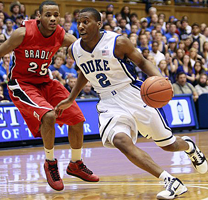 Duke's Nolan Smith drives around Bradley's Walt Lemon and ends the game with 10 assists. (AP)