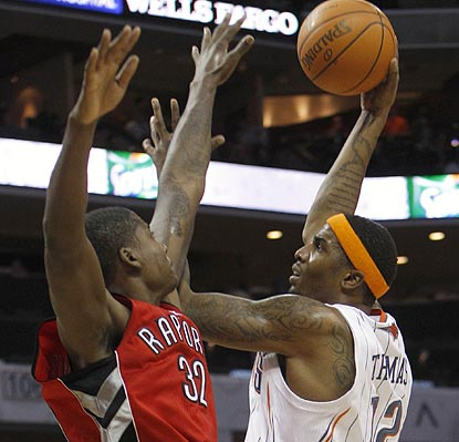 Charlotte's Tyrus Thomas attempts a hook shot over Toronto's Ed Davis in the second half.  (AP)