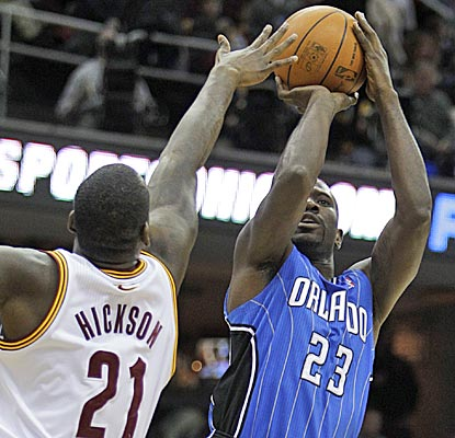 Orlando newcomer Jason Richardson shoots over Cleveland's J.J. Hickson en route to a 20-point night.  (AP)