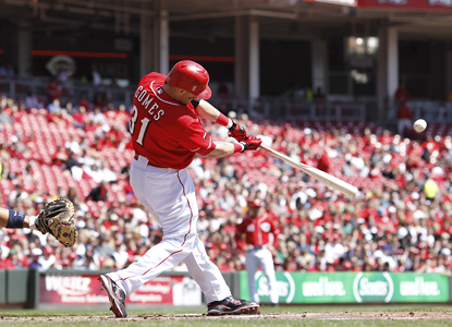 Jonny Gomes connects for a solo home run in the second inning as the Reds sweep the Brewers. (Getty Images)