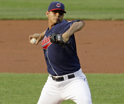 Carlos Carrasco retires the first 13 batters, pitching a three-hit shutout over 8 1/3 innings. (AP)