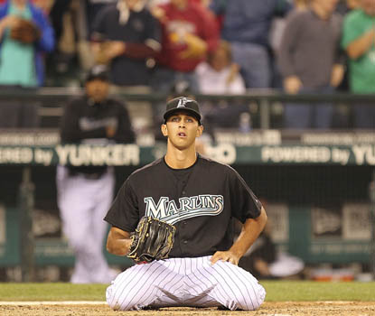 Florida's Steve Cishek sits helplessly at home plate after his wild pitch plates the winning run. (Getty Images)