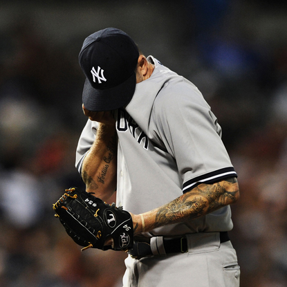 A.J. Burnett buries his head in frustration while getting shelled for six runs in the second inning.  (Getty Images)