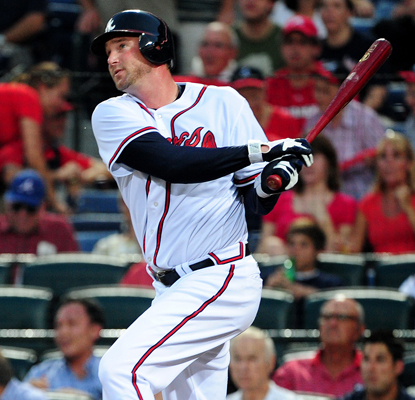 Atlanta's Derek Lowe hits his first career home run in the third inning against the Nationals.  (Getty Images)
