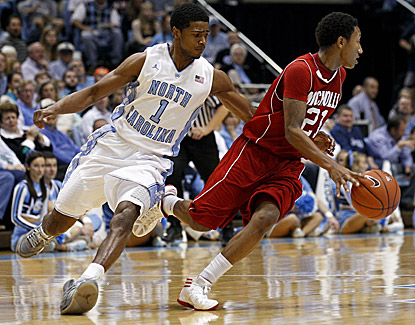 North Carolina's Dexter Strickland, who guards Nicholls State's Shane Rillieux, scores 14 points in the Tar Heels' win. (AP)