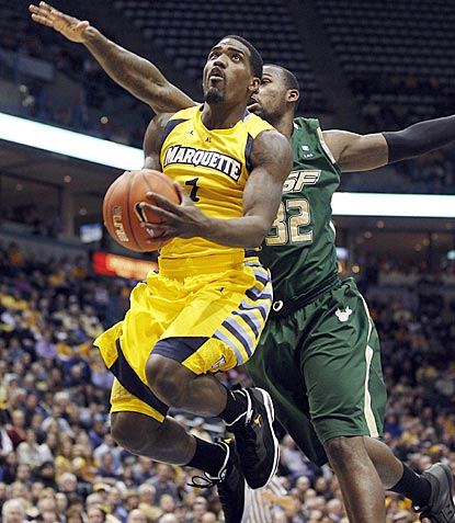 Marquette's Darius Johnson-Odom drives past South Florida's Toarlyn Fitzpatrick during the first half.  (AP)