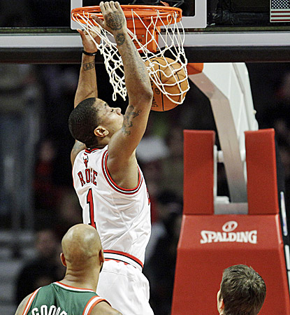 Derrick Rose slam dunks two of his season-high 34 points in the Bulls' 107-100 win over the Bucks. (AP)