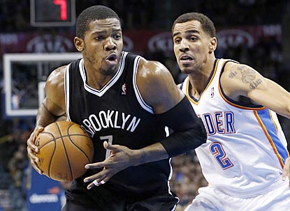 Joe Johnson drives past Oklahoma City's Thabo Sefolosha in the second quarter, during which he scores eight of his 33 points. (AP)